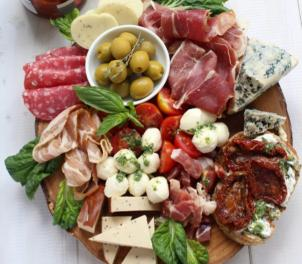 meats and cheeses on fancy tray with olives