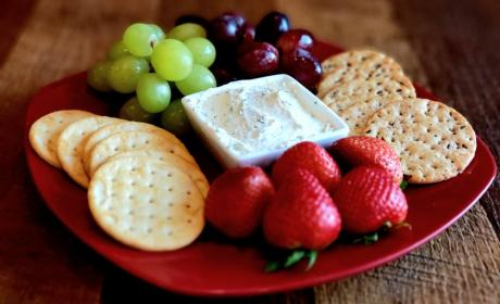 Soft Spreadable Cheese, Crackers, & Seasonal Fruit